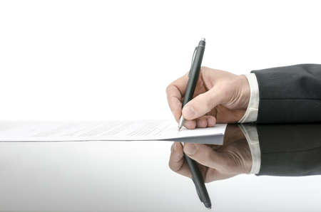 Signing a contract on a black table  With copy space and reflection