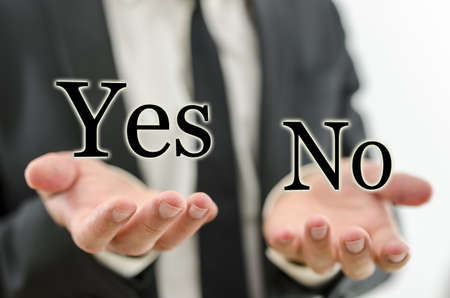 Hand of businessman weighing word Yes and No. Concept of decision making.