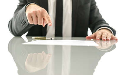Businessman showing where to sign a contract or insurance papers.