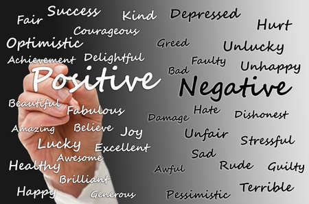 Photo pour Writing positive and negative aspects of life on virtual board. - image libre de droit