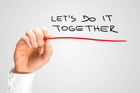 Foto de Close up Conceptual Handwritten Red Underline on Lets Do It Together Texts Isolated on Gray Background. - Imagen libre de derechos