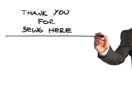 Closeup of male hand writing a Thank you for being here note on a white virtual screen. Conceptual of care and support for someone in need.