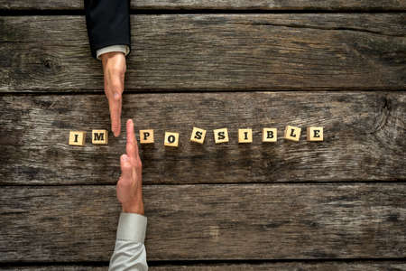 Personal consultant and his client joining forces to change the word Impossible into Possible. Conceptual of change of personal perspective towards life, career and obstacles.