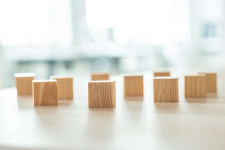 Foto de Wooden blocks randomly placed on office desk. Conceptual of business vision and challenge. - Imagen libre de derechos