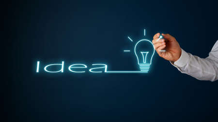 Photo for Word Idea continuing in to a light bulb drawn on digital interface over navy blue background. - Royalty Free Image