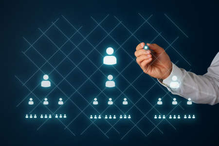Photo pour Network marketing concept with businessman drawing people icons and pyramid scheme on virtual interface with a glowing stylus pen. - image libre de droit