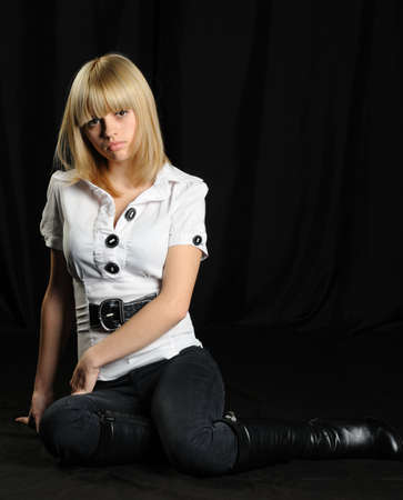 Portrait of the young attractively girl. Hair of wheaten color. A dark back