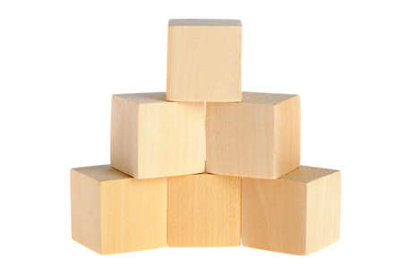 construction from wooden cubes. It is isolated on a white background