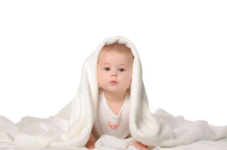 Photo pour The baby under a towel. Age of 8 months. It is isolated on a white background - image libre de droit