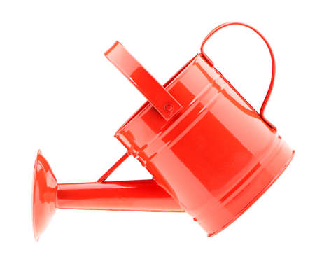Red watering can. It is isolated on a white background