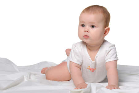 Photo pour The baby on a bedsheet. Age of 8 months. It is isolated on a white background - image libre de droit