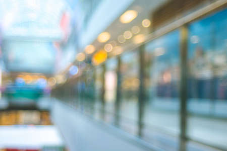 Blurred mall center space with windows shops