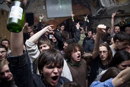 yound people in a crowd cheering at a concert in romania