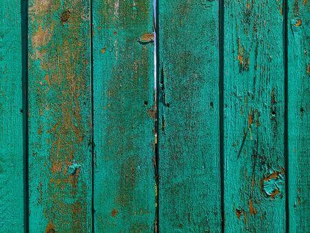 Foto de Green wood texture background. .Old ragged painted fence. - Imagen libre de derechos