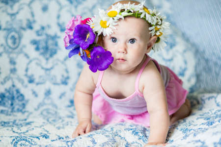 Photo pour .7 month old baby girl on the bed looking at the camera - image libre de droit