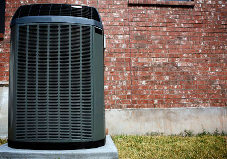 High efficiency modern AC-heater unit, energy save solution in front of brick wall