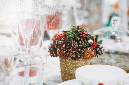 Photo pour Candle, christmas wreath of fir branches, teapot and cups on kitchen, cozy home, scandinavian design - image libre de droit
