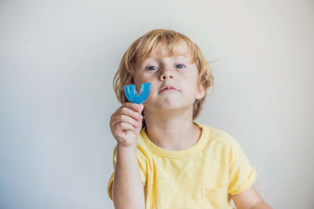 Three-year old boy shows myofunctional trainer to illuminate mouth breathing habit. Helps equalize the growing teeth and correct bite. Corrects the position of the tongue.