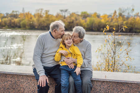 Photo pour Senior couple with baby grandson in the autumn park. Great-grandmother, great-grandfather and great-grandson. - image libre de droit