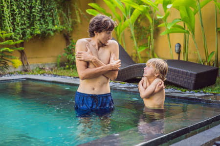 Photo for Dad and son was frozen in the pool. Very cold water in the pool. Need heated water - Royalty Free Image
