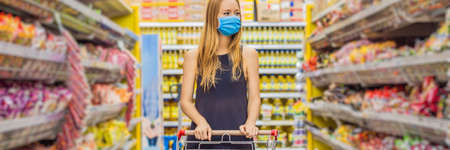 Foto für Alarmed female wears medical mask against coronavirus while grocery shopping in supermarket or store- health, safety and pandemic concept - young woman wearing protective mask and stockpiling food BANNER, LONG FORMAT - Lizenzfreies Bild