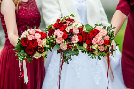 Photo for Bouquets of flowers in the hands of the bride and bridesmaids - Royalty Free Image
