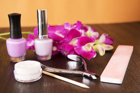 Foto de Manicure tools on a wooden table with Orchid - Imagen libre de derechos