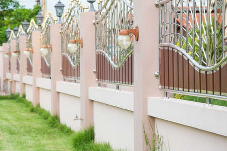 Foto per Solid Privacy stainless steel fence luxurious contemporary decorative light fixtures. Fence With Gate - Immagine Royalty Free
