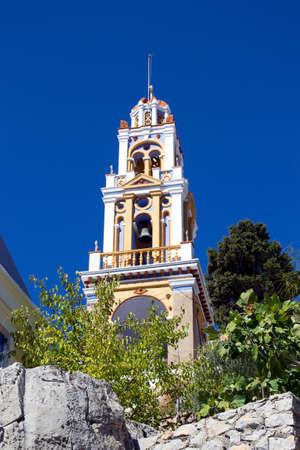 Church tower on the blue sky. The island of Symi. Greece