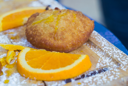 Sicilian pastries filled with orange cream.closeup