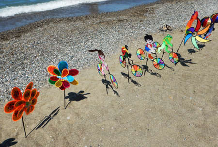 colorful pinwheels on the beach