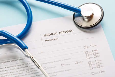 Foto de Stethoscope and patient medical history form. Health check diagnostics concept - Imagen libre de derechos