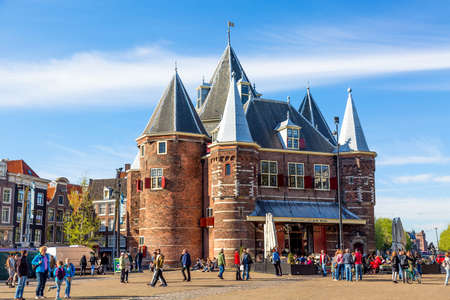 Photo for Amsterdam, Holland - May, 2018: De Waag medieval building on Nieuwmarkt square or New Market square with blue sky - Royalty Free Image
