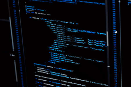 Photo pour Information technology concept. Coding programmer language script text on screen monitor display. Programmer occupation job. Selective focus. - image libre de droit