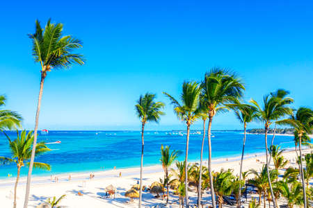 Photo for Beach vacation. Aerial drone view of tropical white sandy Bavaro beach in Punta Cana, Dominican Republic. Amazing landscape with palms, umbrellas and turquoise water of atlantic ocean. - Royalty Free Image