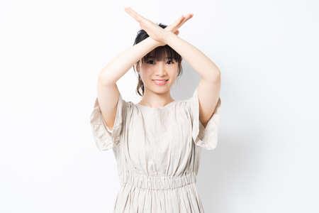 Photo pour Young woman making an NO gesture shot in the studio - image libre de droit