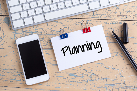 Paper note with text Planning