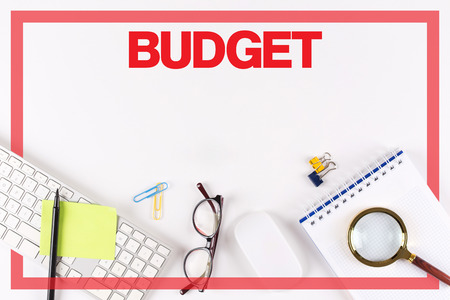 High Angle View of Various Office Supplies on Desk with a word BUDGET