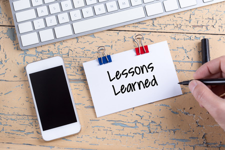 Paper note with text Lessons Learned
