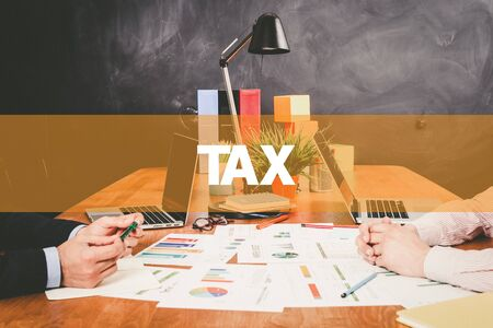 Two Businessman Tax working in an office