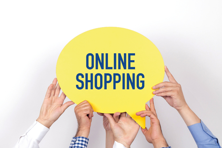 Group of people holding the ONLINE SHOPPING written speech bubble