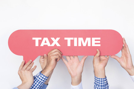 Group of people holding the TAX TIME written speech bubble