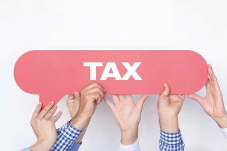 Group of people holding the TAX written speech bubble