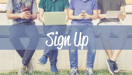 Group of people using mobile devices and SIGN UP concept