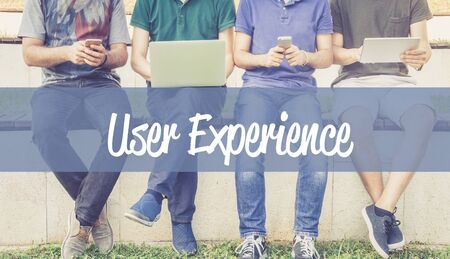Group of people using mobile devices and USER EXPERIENCE concept