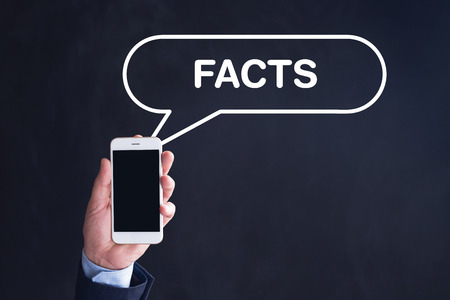 Hand Holding Smartphone with FACTS written speech bubble