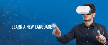 Future Technology and Business Concept: The Man with Glasses of Virtual Reality and touching LEARN A NEW LANGUAGE button