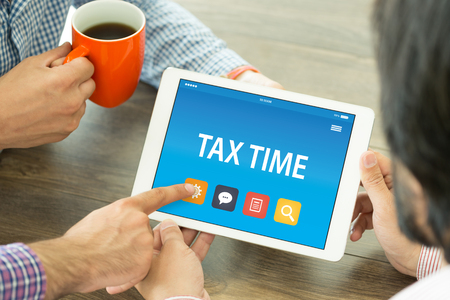 TAX TIME CONCEPT ON TABLET PC SCREEN