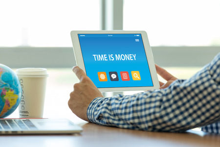TIME IS MONEY CONCEPT ON TABLET PC SCREEN