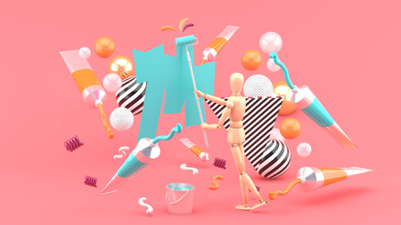 Photo pour Wooden puppet Painting amidst colored tubes and colorful balls on a pink background.-3d render. - image libre de droit